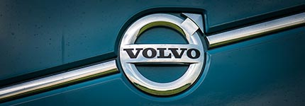 Logo on blue green Volvo truck in Kleyn Stock