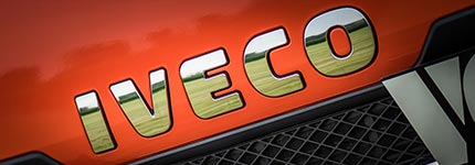 Red Iveco Trucks logo on Iveco truck grill